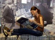 Woman, newspaper (photo: AP)