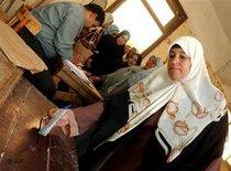 Woman dressed with headscarf at the ballot box (photo: AP)