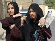 Two young women wearing a headscarf (photo: AP)