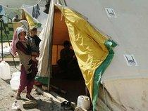 Young mother and child in Pakistan in front of a tent provided by Islamic Relief (photo: website Islamic Relief)