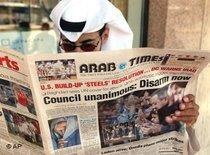 A Kuwaiti man reads the Arab Times, photo: AP