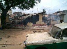 A car passing by a destroyed mosque in Onitsha, Nigeria (photo: AP)
