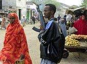 Armed man at a local market (photo: AP)