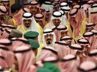 Saudi King Abdullah bin Abd al-Aziz, center, is surrounded by hundreds of Islamic clerics, tribal chiefs and other prominent Saudis before he receives oaths of loyalty in a traditional Islamic investiture ceremony that bestows his legitimacy (photo: AP)