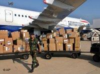 A British Airways plane brings boxes of humanitarian aid and supplies to the Rafik Hariri International Airport, Beirut (photo: AP)