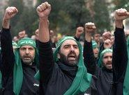 Hizbollah fighters at a rally (photo: AP)