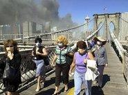 Women fleeing Manhattan across Brooklyn Bridge on 9/11 (photo: AP)