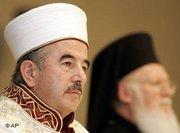 Ali Bardakoglu, head of Turkey's Religious Affairs Directorate, left, accompanied by the Ecumenical Orthodox Patriarch Bartholomew I, during religious conference in Istanbul (photo: AP)