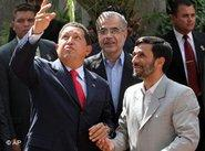 Venezuela's President Hugo Chavez, left, gestures as he talks with Iranian President Mahmoud Ahmadinejad, right, before an official welcoming ceremony for Chavez in Tehran, Iran, 29 July 2006 (photo: AP)