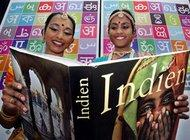 Two Indian women and a book (photo: AP)