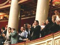Armenians applaud after debates on the Armenian genocide at the National Assembly in Paris (photo: AP)