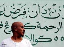 A Muslim outside a mosque in downtown Kuala Lumpur (photo: AP)
