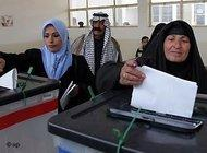 Two women cast their votes at a polling station in Baghdad (photo: AP)