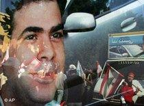 Reflection of Pierre Gemayel on a car window during his funeral (photo: AP)