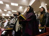 Afghan parliament members hold copies of the holy book Quran during their swearing-in ceremony in Kabul, Afghanistan (photo: AP)