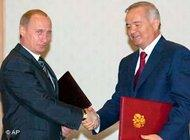 Russian President Vladimir Putin, left, and Uzbekistan's President Islam Karimov shake hands after the signing ceremony in Tashkent, the capital of Uzbekistan, 16 June 2004 (photo: AP)