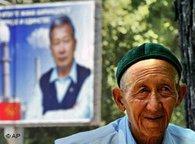 A Kyrgyz man passes a poster of acting Kyrgyz President and presidential candidate, Kurmanbek Bakiyev in Bishkek, Kyrgyzstan, 7 July 2005