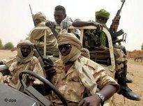 Sudan Liberation Army (SLA) soldiers patrol the town of Muhujariya (photo: dpa)