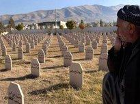 Man sits in a graveyard where the dead of the 1988 gas attack on Halabja were laid to rest (photo: AP)