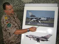 German ISAF soldier explaining the use of the Tornado reconnaissance planes (photo: AP)
