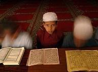 A boy in a madrasa, a religious school, in Afghanistan (photo: AP)
