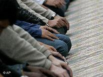 Bosnian Muslims perform their traditional Friday prayers in a mosque (photo: AP)