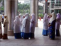 Women with headscarves, Malaysia (photo: Yale Global)