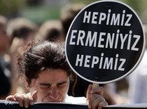 A demonstrator weeps as she holds a placard that reads: 'We are all Armenians' near a courthouse in Istanbul (photo: AP)