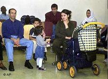 Migrant family in a naturalization office in Hamburg, Germany (photo: AP)