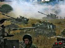 Israeli artillery pieces fire across the border into southern Lebanon (photo: AP)