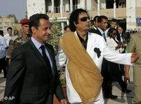 Libyan leader Moammar Qaddafi welcomes French President Nicolas Sarkozy in Tripoli (photo: AP)