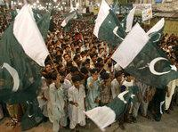 Pakistan citizens wave national flags at a rally to celebrate their country's Independence Day, 14 August 2007, in Rawalpindi, Pakistan (photo: AP/Anjum Naveed)