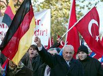 Turkish nationals living in Germany wave Turkish and German flags (photo: AP)