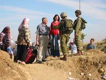 Palestinians and Israeli soldiers at a checkpoint (photo: www.machsomwatch.org)