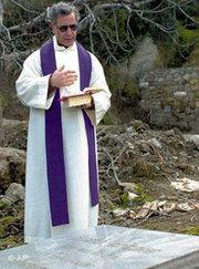Italian Roman Catholic priest Andrea Santoro was shot in the chest with a single bullet, hours after a Sunday mass, in Black Sea city of Trabzon, Turkey, February 2006. His body was found in the courtyard, just outside the door of the 19th Century Santa Maria Church, which was built under Ottoman Sultan Abdulmecid to serve Christians visiting Trabzon. Officers were searching for a teenage boy who witnesses said carried out the attack, according to a police official. (photo: AP)