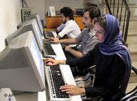 Iranians work at an internet cafe in Tehran, 8 August 2006 (photo: AP)
