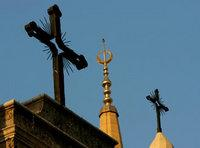 A minaret of the Mohammed al-Amin Mosque and two crosses on top of the Maronite St George Cathedral are seen in downtown Beirut, Lebanon (photo: AP)