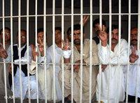 Unidentified Pakistani protesters flash victory signs from a police lock-up facility in Multan, 7 November 2007 (photo: AP)