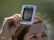 A demonstrator holds up a picture of Hrant Dink (photo: AP)