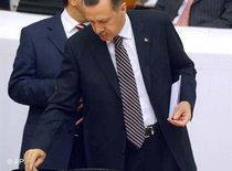 Prime minister Erdogan taking part in a vote (photo: AP)