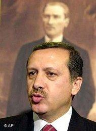 Erdogan with a poster of Kemal Ataturk in the background (photo: AP)