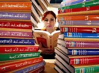 A reader looks through a shelf of Arabic books (Photo: AP)