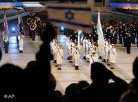 An Israeli waves a national flag during the official ceremony for Independence Day on Mt. Herzl in Jerusalem, 7 May 2008  (photo: AP)