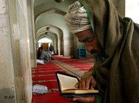 An Afghan Muslim in a mosque, reading the Koran (photo: AP)