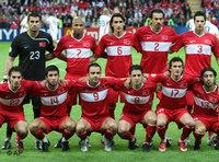Back row from left, Turkey's Volkan Demirel, Mehmet Aurelio, Mehmet Topal, Servet Cetin, Hakan Balta, and front row from left, Hamit Altintop, Arda Turan, Semih Senturk, Nihat Kahveci, Tuncay Sanli, and Emre Gungor pose for a team photo prior to the group A match between Turkey and Czech Republic (photo: AP)