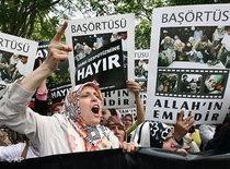 Islamic demonstrators in Ankara shout slogans to protest a head scarf ban (photo: AP)
