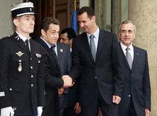 Bashar Assad and Nicolas Sarkozy shake hands (photo: AP)