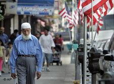 A Muslim man makes his way along Coney Island Avenue, in the Midwood neighborhood of the Brooklyn borough of New York (photo: AP)