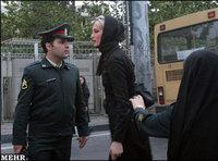 Iranian police officers interrogate a woman on her clothing (photo: MEHR)