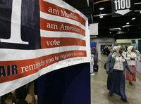 A sign in the bazaar at the 43rd annual ISNA convention in 2006 encourages participants to register to vote (photo: AP)